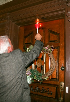Blessing the home at the entryway.